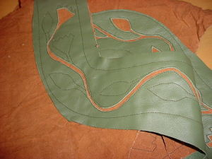 Then you start cutting away everything between the lines of stitching.  Hence the name, Reverse Applique.  This is also a good OCD project.