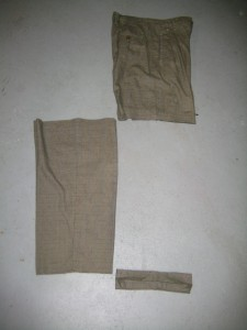 Cut the pant leg an inch below the knee of the wearer.  Logically, knees are about midway down the leg, but if you're working with children you should measure.  Also cut off the bottom cuff of the pant - you'll need it in the next step.