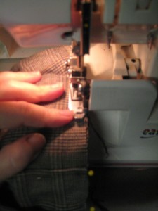 Pin the cuff to the pant, right side of cuff to wrong side of pant.  Sew, so the seam is on the outside.  Flip cuff up, to cover seam.  Tack in place at sides, so seam stays hidden.