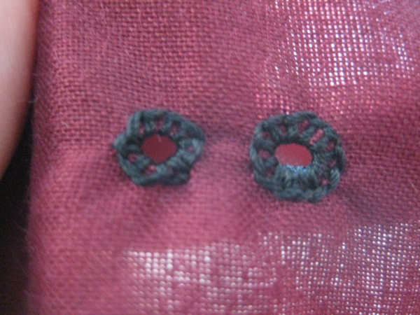 Finished eyelets, front side shown.