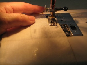 """Start the hem with 2-4 straight stitches, 1/2"""" from the hem edge."""