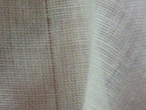 Once the thread is pulled, you can see a line in the fabric where the thread was.