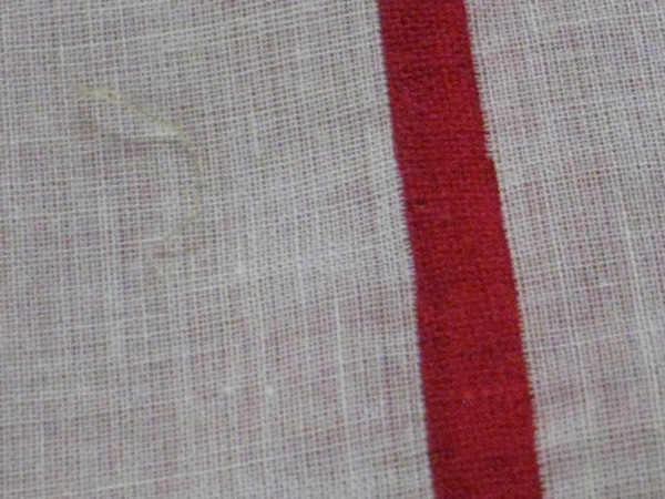 Eventually, you have a perfectly straight cut that follows the grain of the fabric.