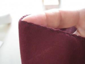 zig-zag stitches over top edge