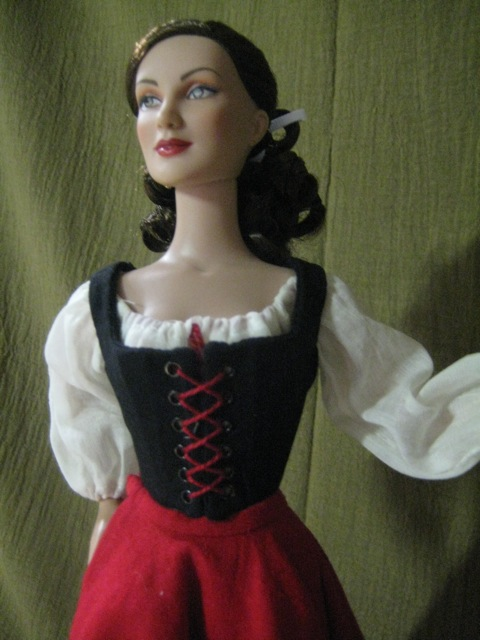 Finished bodice, worn by doll.