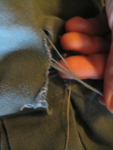 loose threads to be snipped from tear