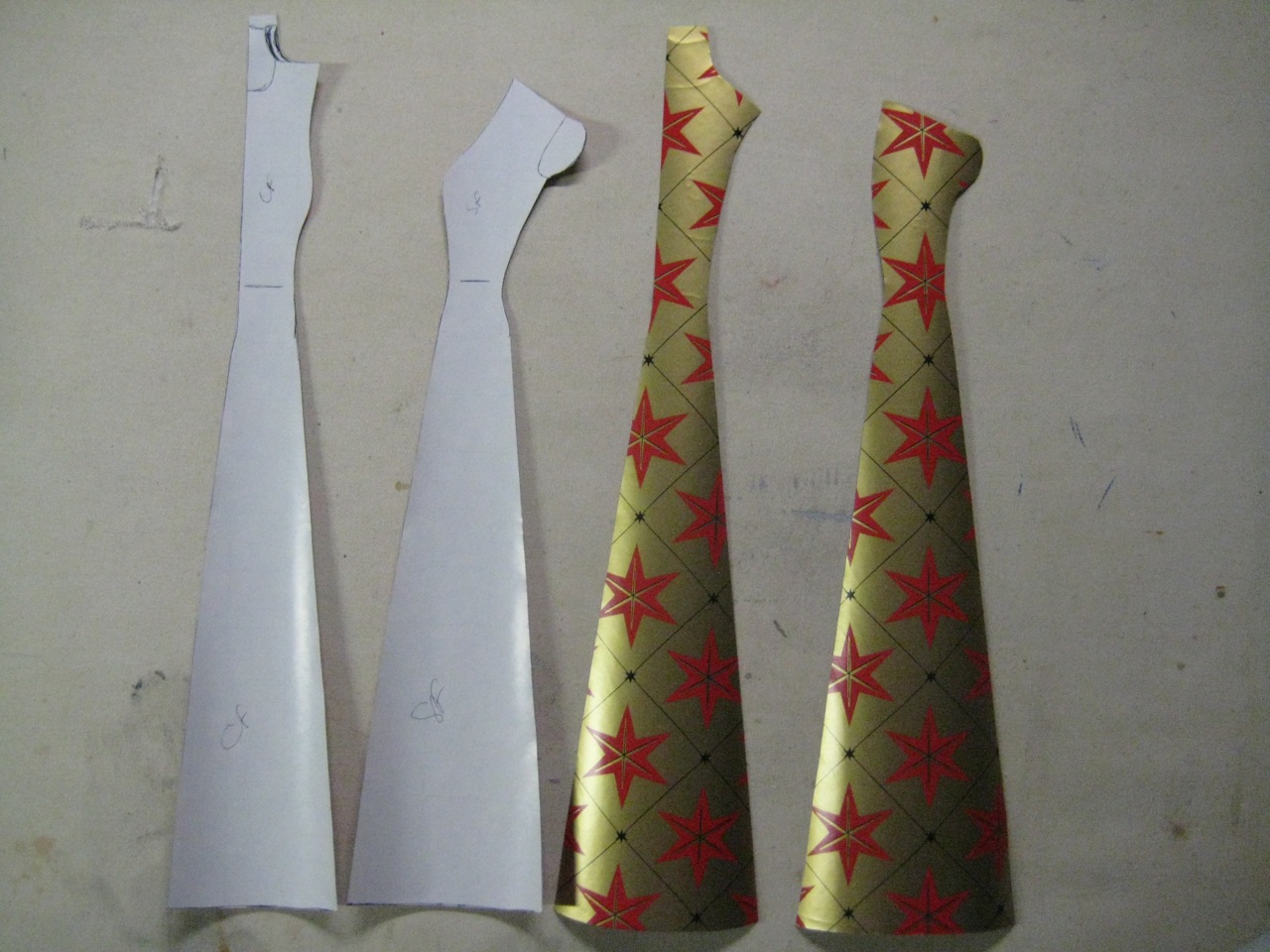 pattern pieces cut from wrapping paper