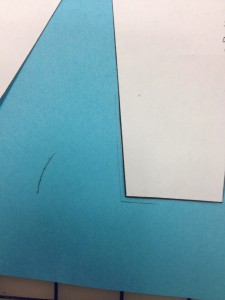 """Mark the inside corner of the dart leg on your paper.  (Sloper moved slightly so you can see this.)  Now mark a small arc 1 1/4"""" from the corner you just drew."""