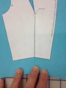 Fold your dart closed with the seam allowances towards the center front of the body.