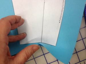 Fold crease the paper along the new bottom line you just drew.