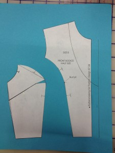 Then we marked a deep, curved V neckline.  We don't want the neckline to take too much out of the buttonhole extension.