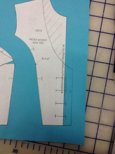 Erase the guides that are past or between buttonholes.  This long bar marks the buttonhole.