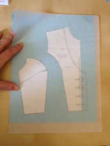 Place a new clean sheet of tracing paper over your work.