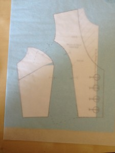 Move your tracing paper again, so that your princess  corners fit the center front piece.  At this point, you can attach this sheet of tracing paper to the one below it so that it doesn't move anymore.  (We're done moving this piece.  I promise!)