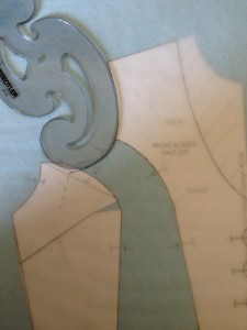 Use a curve and your guidelines from the side front piece to draw in a smooth armscye.