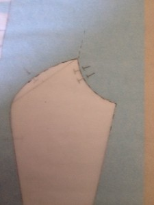 Move the sheet of tracing paper until the upper princess corner fits the upper side back, then mark guides for the armscye and an inch of the side line.