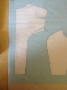 Match the princess corners back up the the center back piece and attach the tracing paper to sheet underneath it.