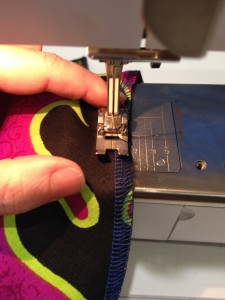 Start your ease stitch just inside the seam allowance.  Place your index finger firmly behind the machine's foot.