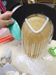 """I've got a craft foam template of the lower """"metal"""" portion of the headdress lined up with the supported ear thing (not yet cut for metal mesh).  I need to mark where the two meet so I can get rid of the extra craft foam."""